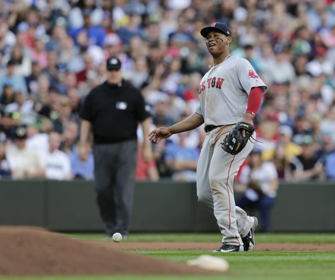 Red Sox third baseman Rafael Devers drops the ball for a fielding error during a June 2018 game against the Mariners in Seattle. Devers made 14 errors in just 57 games during the 2020 season. [AP, file / John Froschauer]
