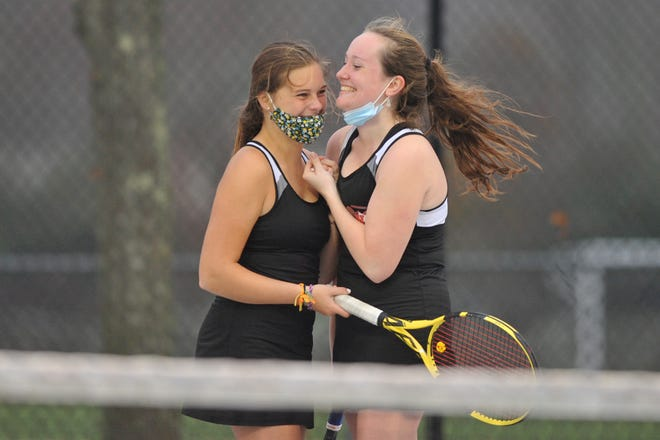 Narragansett's Shelby Lefoley, left, and Emma Murphy celebrate after their win at No. 1 doubles that clinched the Mariners' D-II semifinal win over Cranston West Wednesday.