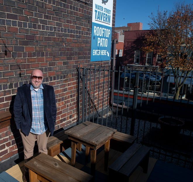 Mike Beder, owner of Water Street Tavern, has a roof top patio for outdoor seating.