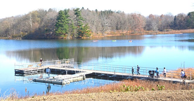 Visitors enjoying the waters of Trail Lake with its fishing pier and canoe and kayak launch.
