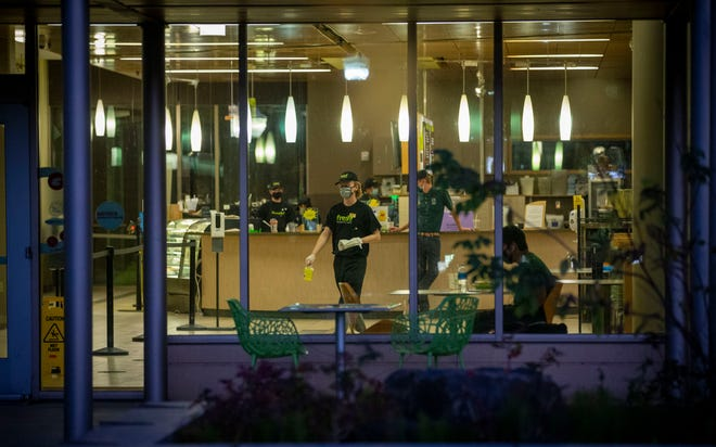 A worker prepares to clean at the University of Oregon's Global Scholars Hall dining facility this week.