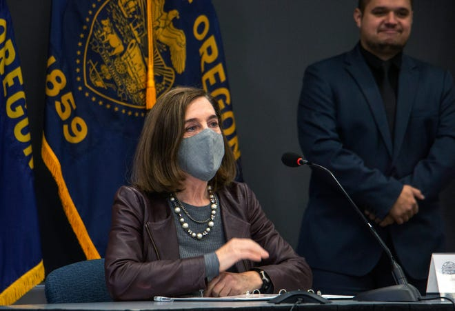 Oregon Gov. Kate Brown attends a news conference Tuesday, Nov. 10, in Portland. Brown and Oregon health officials warned Tuesday of the capacity challenges facing hospitals as COVID-19 case counts continue to spike in the state.