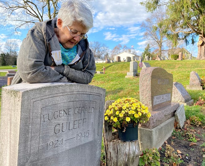 Vickie Menges, president of the Dalton Community Historical Society, stands at the gravesite of her late father at Dalton Cemetery. The cemetery recently received a grant through the Oho Department of Commerce for maintenance and improvements.