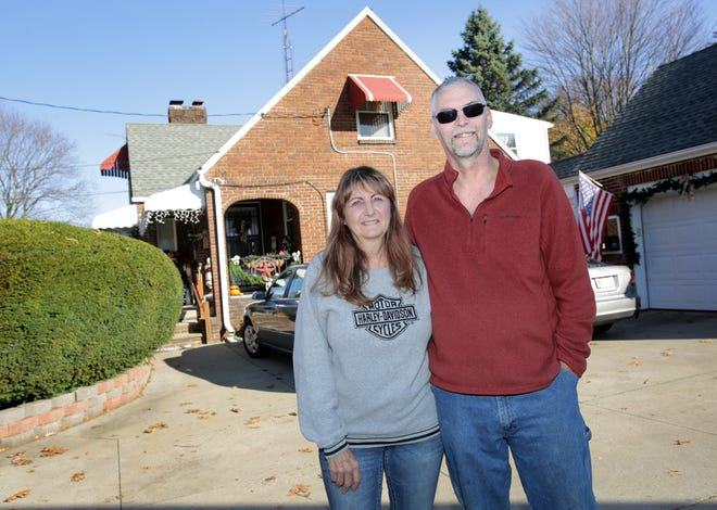 Jacklyn and Wayne Brock outside their Perry Township home.