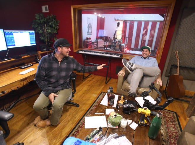 Hey Monea members Dan Monea (left) and Nate Monea share a laugh in Little C  Studio, their new recording studio in Canal Fulton on Thursday, Nov. 12, 2020.