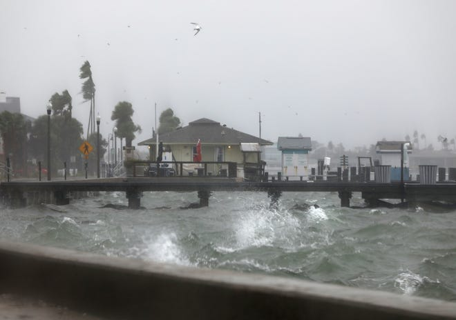 Water splashes against the seawall along Pass A Grille Way in St. Pete Beach on Wednesday as squalls from Tropical Storm Eta move through Pinellas County. Eta has weakened to a tropical storm just hours after regaining hurricane strength as Florida braces for a second hit from the storm.