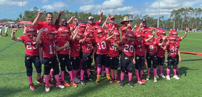 Members of the Sarasota Sun Devils pose after defeating the Fort Myers Firecats for the Peace River Conference championship. The Sun Devils will play the Westchase Colts at 10 a.m. Saturday in Cape Coral in the first round of the regionals.