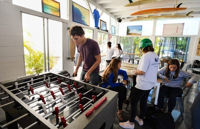 Nathaniel Fenton plays foosball in the lounge of The 180 House in Venice in April 2019.