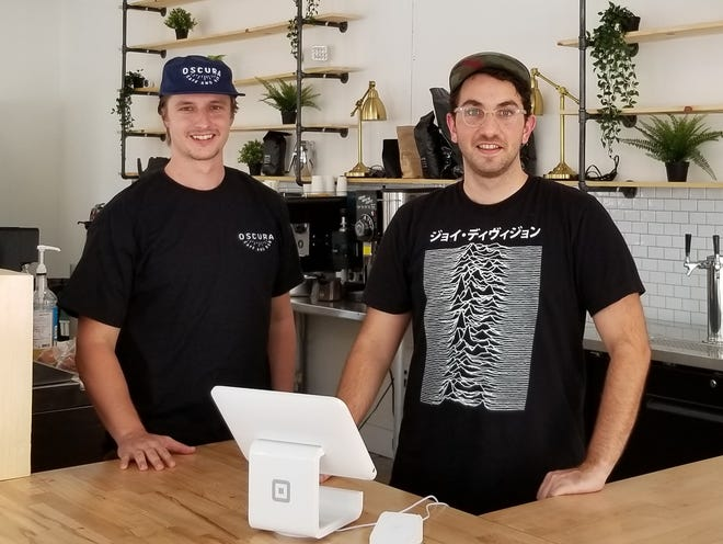 Before the pandemic, co-owners Ben Greene, left, and Keith Nasewicz thrived at Oscura Cafe & Bar in downtown Bradenton, servingbreakfast, lunchand lots of coffee and teato office workers during the week.