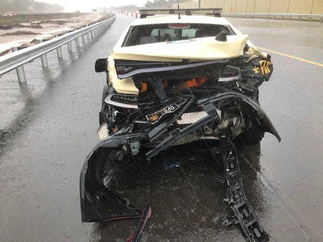 A Florida Highway Patrol trooper received minor injuries when his Dodge Charger was struck by another car on Wednesday on Interstate 75 in Manatee County.