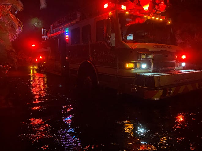 High water rescue vehicles were needed to rescue four people from Tropical Storm Eta-related flooding Wednesday on Longboat Key.