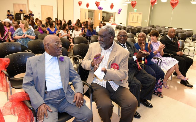Robert L. Taylor, left, and Fredd Atkins attend an event in 2015 marking Newtown's 100th anniversary at the Robert L. Taylor Community Complex.
