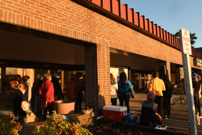 Dozens of people came out for a rally in front of the New Hanover County Board of Elections Wednesday Nov. 4, 2020 in Wilmington, N.C. The event was to help celebrate everyone who worked during the election and continues to count each vote that was cast by local voters.