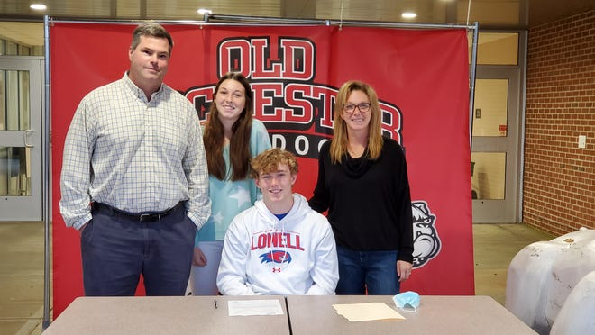 Ryan Quilan is all smiles after signing his National Letter of Intent to play lacrosse at UMass Lowell. He is joined by his father, Henry, sister Kelly and mom Maureen.