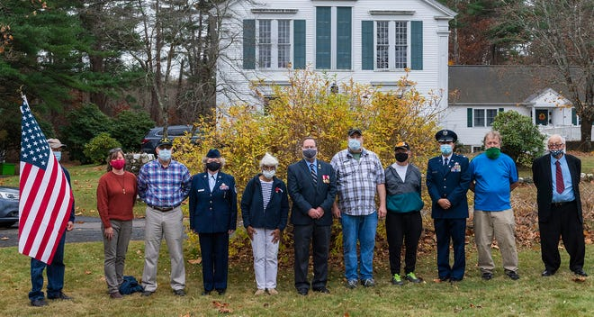 Local veterans gather for a photo at the conclusiong of Veterans Day observances in Lakeville. [Bud Morton/The Gazette/SCMG]