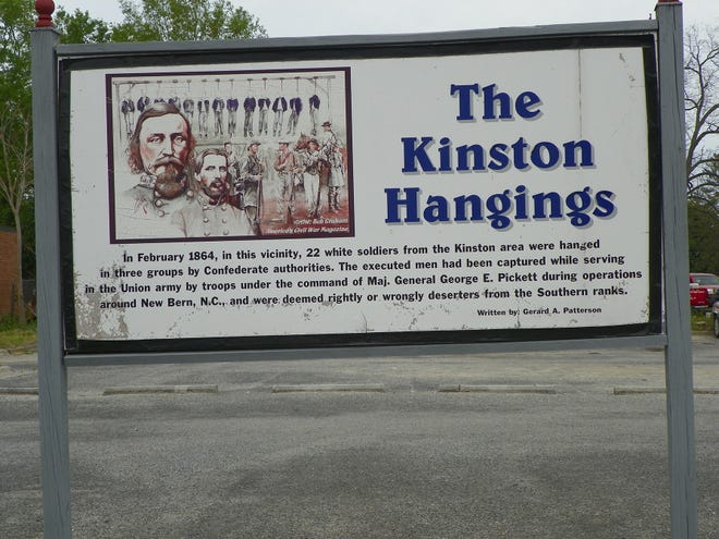 This sign (which is now in storage at the CSS Neuse Museum in Kinston) commemorates the hanging of 22 Union soldiers, former Confederates who were captured by their former allies in 1864. [Contributed picture]