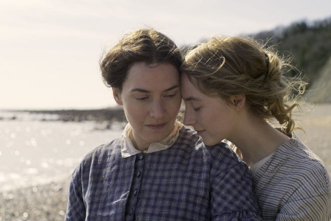 "Kate Winslet, left, and Saoirse Ronan star in  ""Ammonite."" (Neon via AP)"