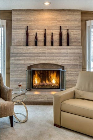 Mixing stone veneers and tiles and utilizing different levels results in beautiful dimension and shape.
