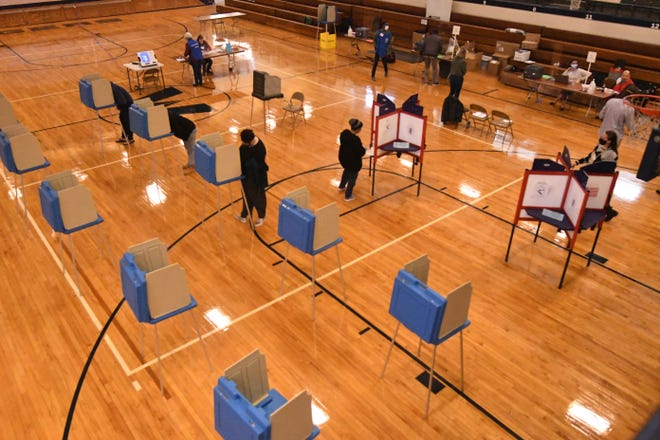 Poll workers and voters were out Tuesday Nov. 3, 2020 at Williston Middle School in Wilmington, N.C. Voting sites will be opened Tuesday until 7:30 pm across southeastern North Carolina to accept ballots from registered voters. [KEN BLEVINS/STARNEWS]