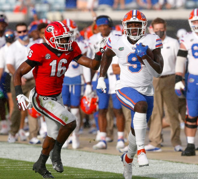 Florida tight end Keon Zipperer runs up the sideline after making a catch Saturday against Georgia at TIAA Bank Field in Jacksonville.