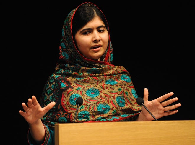 Malala Yousafzai speaks during a media conference at the Library of Birmingham in Birmingham, England in October 2014, after she was named winner of The Nobel Peace Prize. The 23-year-old will speak via Zoom at the University of Florida on Nov. 18.