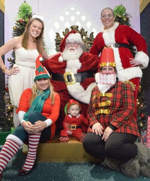 Santa poses with his helpers at Holly Hill Mall in Burlington. He will make his return on Nov. 14 at 2 p.m. Visiting hours will continue through Christmas Eve.