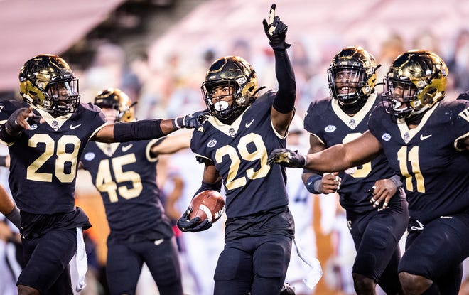 Wake Forest freshman defensive back Caelen Carson, middle, celebrates an interception against Virginia in a game last month. The Demon Deacons lead the country in turnover margin at plus-14.
