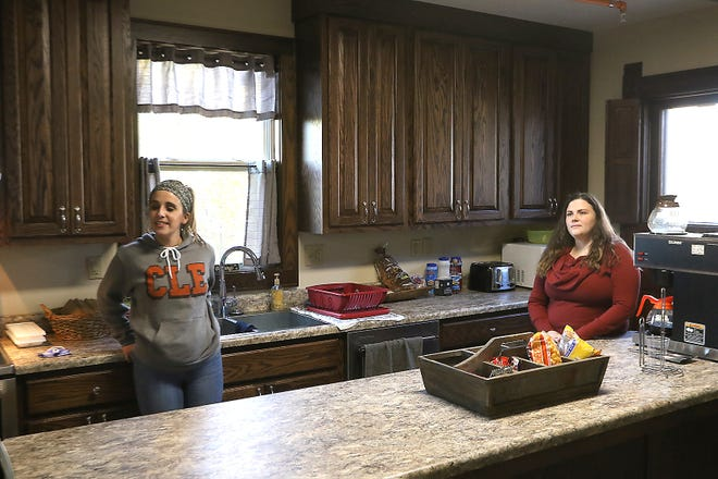 Megan Scharver, counselor, and Haley McFarland, director of recovery services for OhioGuidestone, stand in the kitchen of River Haven Women's Residential Treatment in Dover. (TimesReporter.com / Jim Cummings)