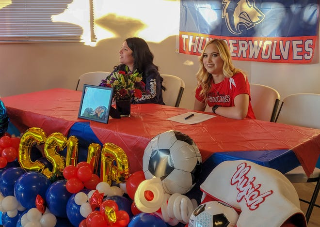 Pueblo Centennial's Mikayla Henson, left, and Laniee Vujcich get ready to sign their letters of intent Wednesday, Nov. 11, 2020 at the home of Henson.