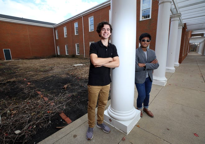 New Albany High School seniors Max Little (left), president of the school's National Honor Society chapter, and Tawfiq Mohammed, treasurer of the chapter, stand in front of the site for the Memorial Grove restoration project for which students will lead the fundraising effort. The Memorial Grove was built as a senior-seminar project in the mid-1990s, said NHS faculty adviser Jenny Core. It was intended as a place for students and staff members to reflect and remember community members who have died, Core said.