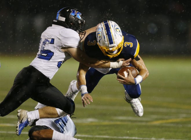Olentangy's Caleb Gossett dives for extra yards Oct. 23 against Worthington Kilbourne. Gossett, one of the team's 17 seniors,  had 31 catches for 382 yards and three scores and added 58 tackles and four interceptions on defense.