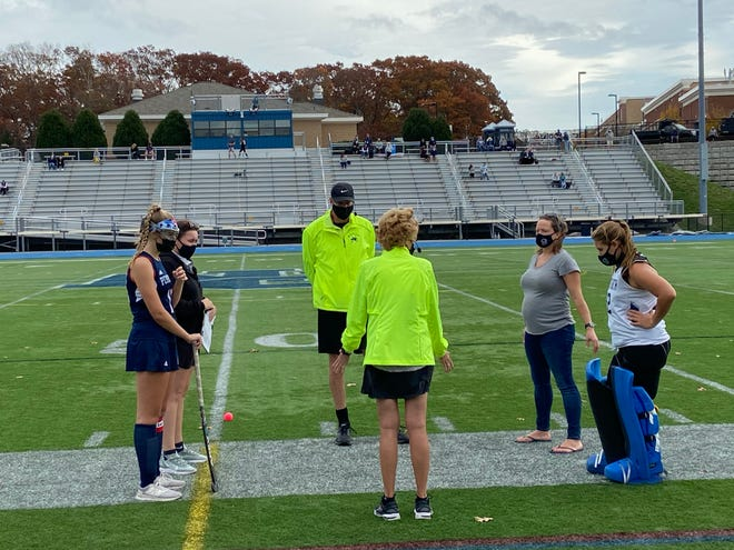 Plymouth North and Pembroke's captains and coaches meet with the officials.