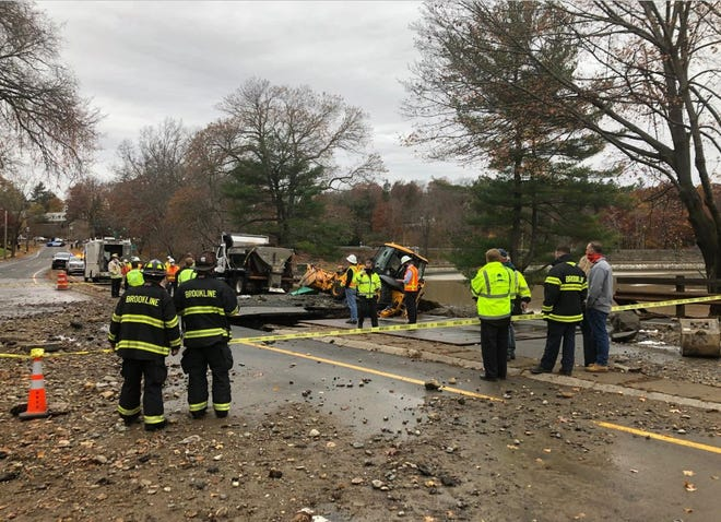 Massachusetts Water Resources Authority officials have confirmed a water main break caused this sinkhole to open.