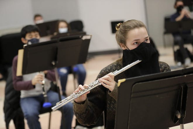 Alison Gauvreau wears an instrumental mask as she plays the flute during band practice at Lawrence University on Nov. 11. Student positions were spread out in the room to practice safe social distancing.