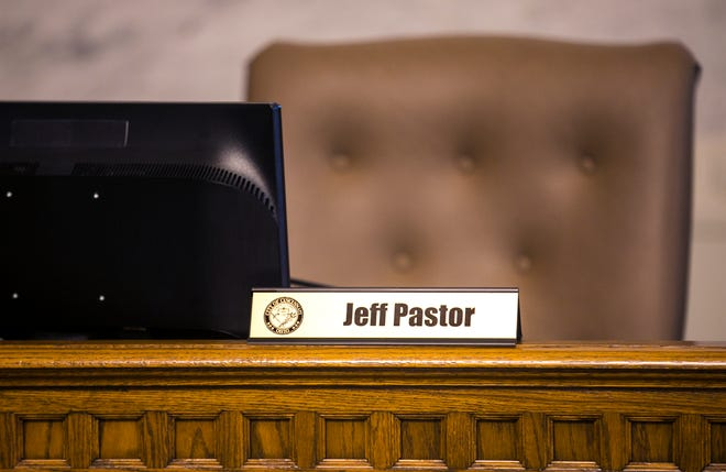 Cincinnati City Council member Jeff Pastor's seat in chambers is empty during the weekly council meeting, Thursday, Nov. 12, 2020. Pastor was indicted on wire fraud, bribery and money laundering Nov. 10. Pastor , 36, is in his first term on council.
