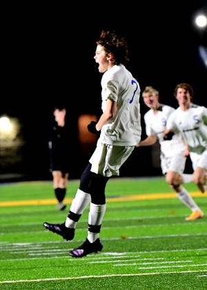 Mariemont's Evan Farrell is jubilant that the Warriors are state championship bound at the OHSAA Division III Boys state soccer semifinal in Springfield, Ohio, Nov. 11, 2020