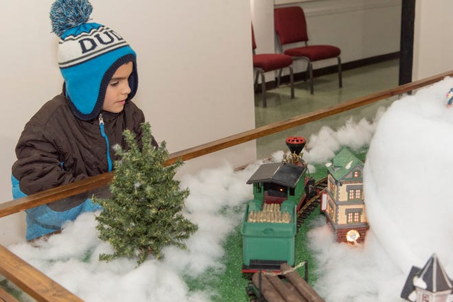 """All ages enjoy the """"Hayes Train Special"""" model train display. This photo was taken during the 2019 holiday season. This year, face-coverings are required, and Hayes Presidential has made some changes to allow for physical distancing."""