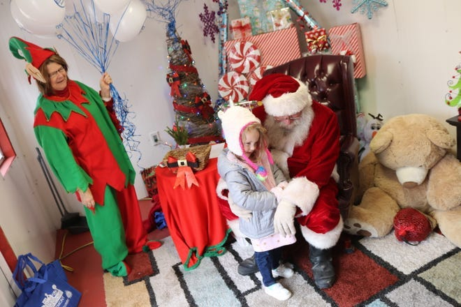 Unlike this photo from December 2019, this year's Santa House in downtown Fremont will feature social distancing, with no one allowed to sit on Santa's lap. The Santa House will open Nov. 27 from 5 to 7 p.m., the same night as the city's tree lighting ceremony.