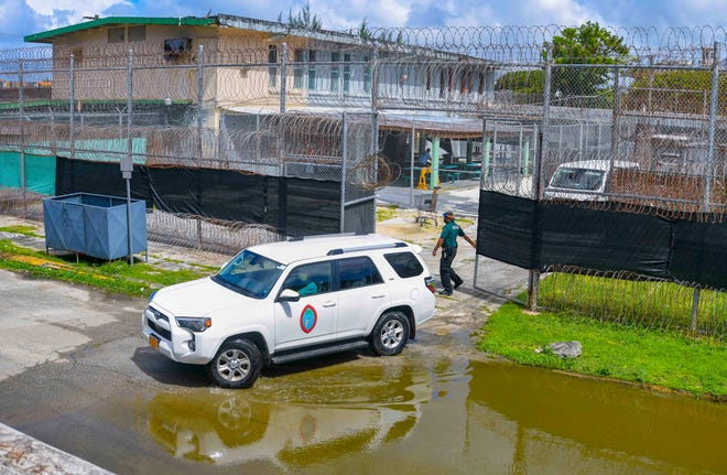 Department of Public Health and Social Services health workers prepare to depart the Department of Correction's Hagåtña Detention Facility after concluding COVID-19 testing on Thursday, Nov. 12, 2020.