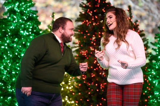 An acapella group preforms at Dollywood's Smoky Mountain Christmas festival at Dollywood, Thursday, Nov. 12, 2020. Over five million lights have been hung on buildings and hundreds of cut and lit Christmas trees can be found around the park.