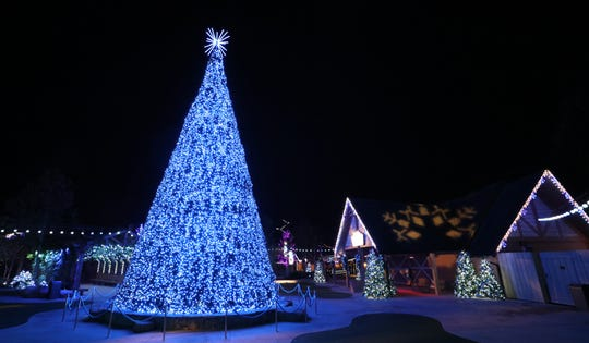 """The """"Wonderful Christmas!"""" tree show in Dollywood's Wilderness Pass Plaza features a 50 feet tall animated tree that presents a fully-synchronized light show."""