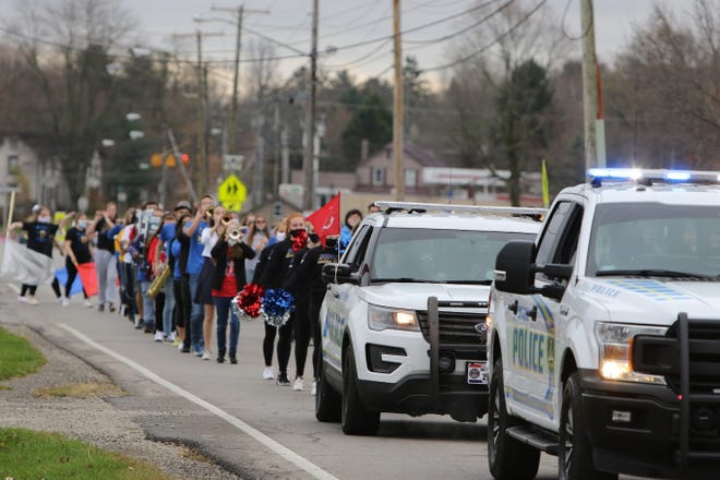 Ontario police and the Ontario High School marching band led the way for the Veterans Day celebration.