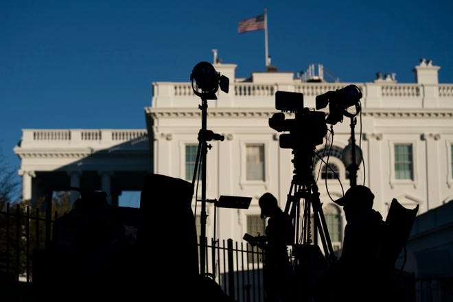 In this Nov. 4, 2020, file photo, media organizations set up outside the White House in Washington. The Associated Press and the major TV networks have long played a major role in announcing the victor in elections based on their own data. There is no national elections commission to tell the world who wins on Election Day, unlike in many other countries. Instead, the news media has historically stepped into this role — a tradition that evolved from the simple need to report the news.