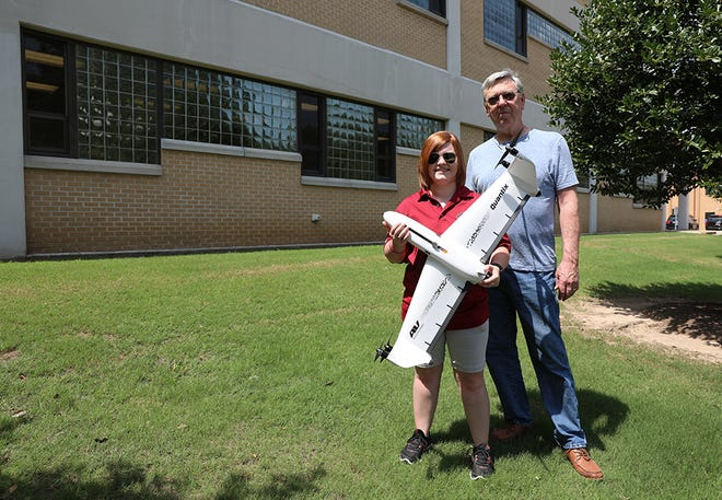 Stephanie Robinson and Paul Karlowitz with a state-of-the-art Quantix drone. Robinson is manager of the University of Louisiana Monroe's Precision Ag and UAS (Unmanned Aircraft Systems) Research Center and Karlowitz is director and associate professor of aviation in the College of Business and Social Sciences.