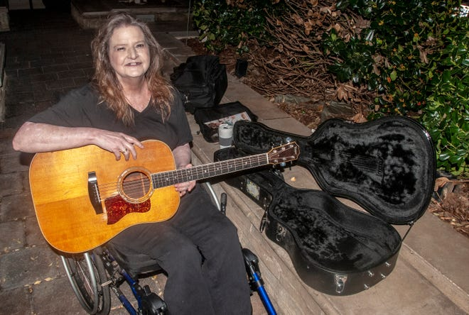 Lisa Busler with her restored 1979 Taylor guitar prior to performing at The Exchange in downtown Montgomery.