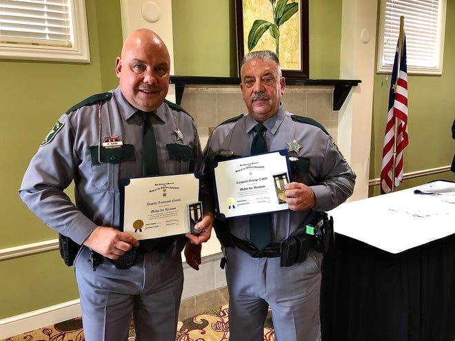 Collier County Sheriff's Deputy Raymond Novak, left, and Collier sheriff's Cpl. George Cahill, right, were honored Nov. 12, 2020, for their heroism in saving a man from a burning house in October 2019.