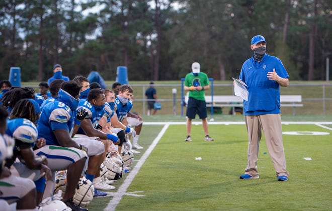 Head coach Pete Shinnick talks with his players during football practice at the University of West Florida in Pensacola on Wednesday, Nov. 11, 2020.