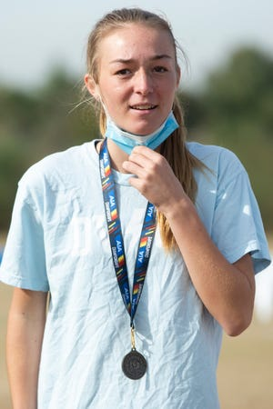 Desert Vista Freshmen Lauren Ping celebrates coming in first for individual girls at the 2020 Cross Country AIA Division I championship meet at Cross Roads Park in Gilbert, Ariz. on Nov. 12, 2020.