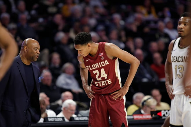 Florida State head coach Leonard Hamilton and Florida State guard Devin Vassell (24) in the second half of an NCAA college basketball game Wednesday, Jan. 8, 2020 in Winston-Salem, N.C. Florida State wins 78-68. (AP Photo/Lynn Hey)