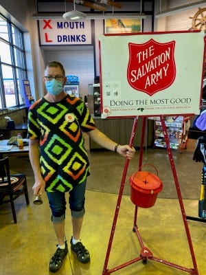 Matt Grotz dons a mask while volunteering as a bell ringer as a part of the Salvation Army of Ottawa County's Red Kettle campaign.